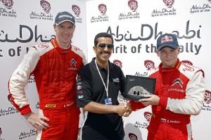 Евгений Новиков получает награду Abu Dhabi Spirit of the Rally