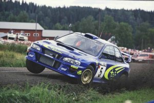Ричард Бернс (Richard Burns) за рулем Subaru WRC, ралли 1999 года